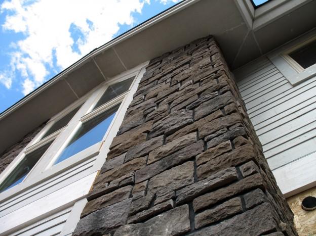 house with stone veneer siding