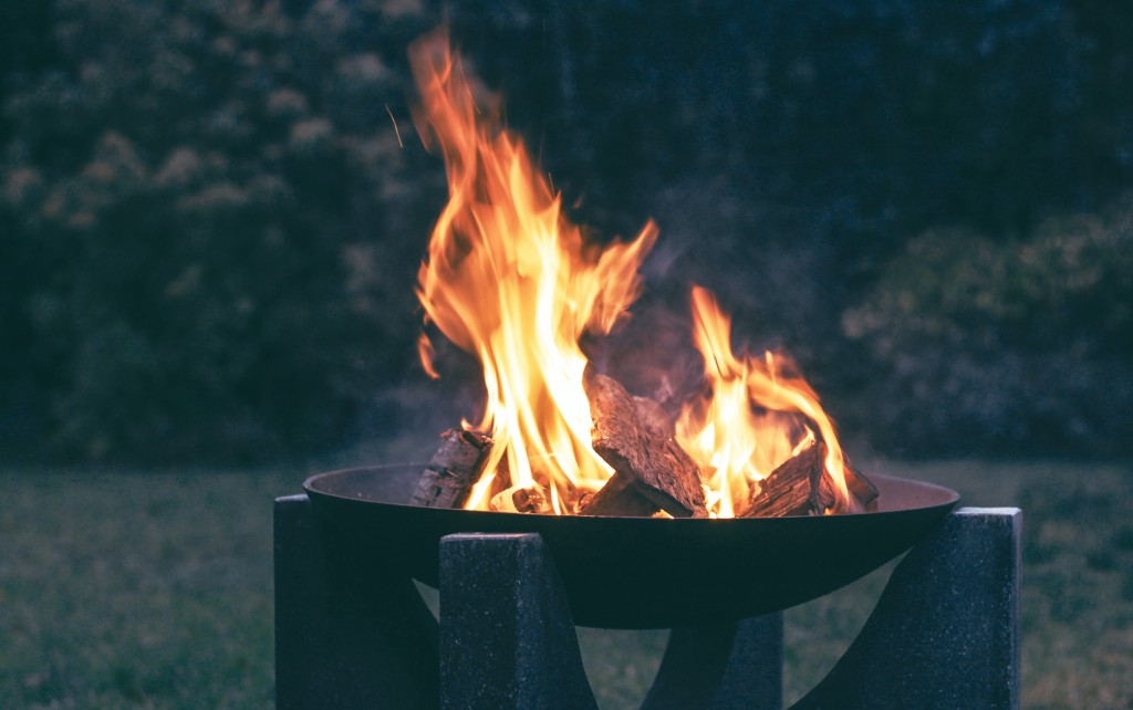 modern fire pit with burning wood