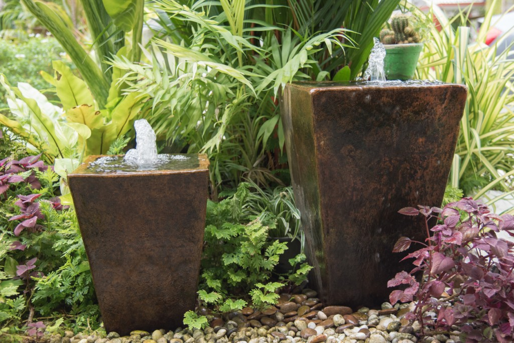 pair of vase fountains in backyard
