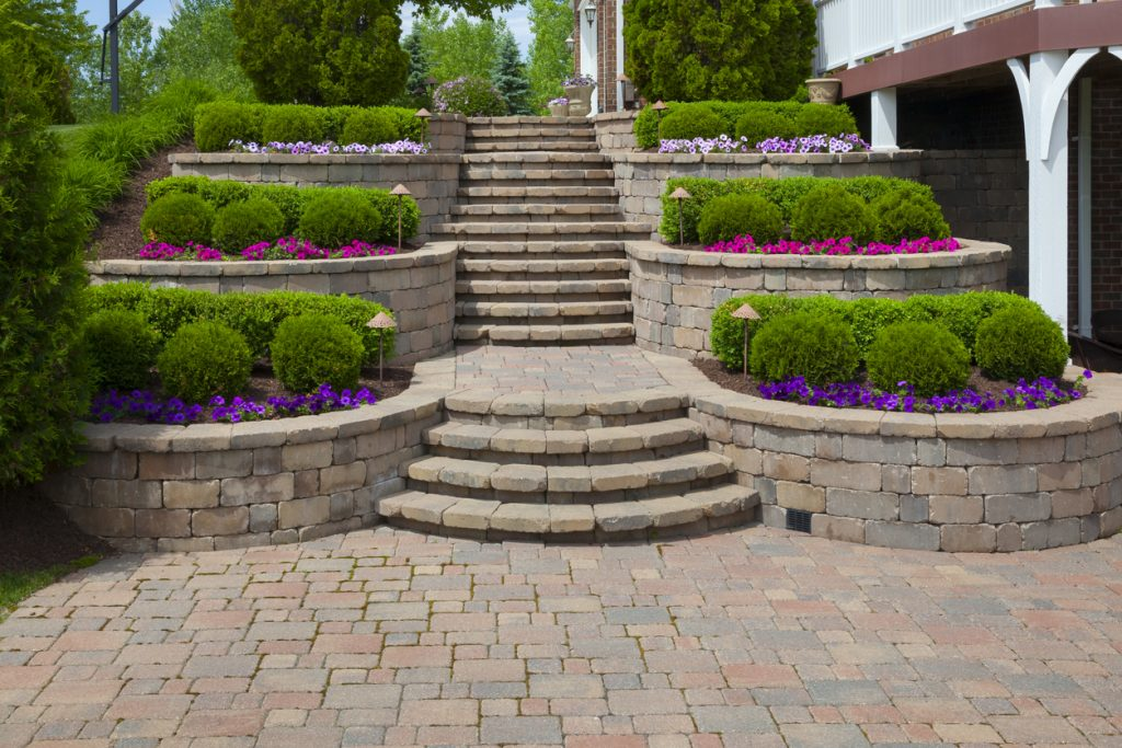 stairs, terraced garden beds, and patio made of pavers