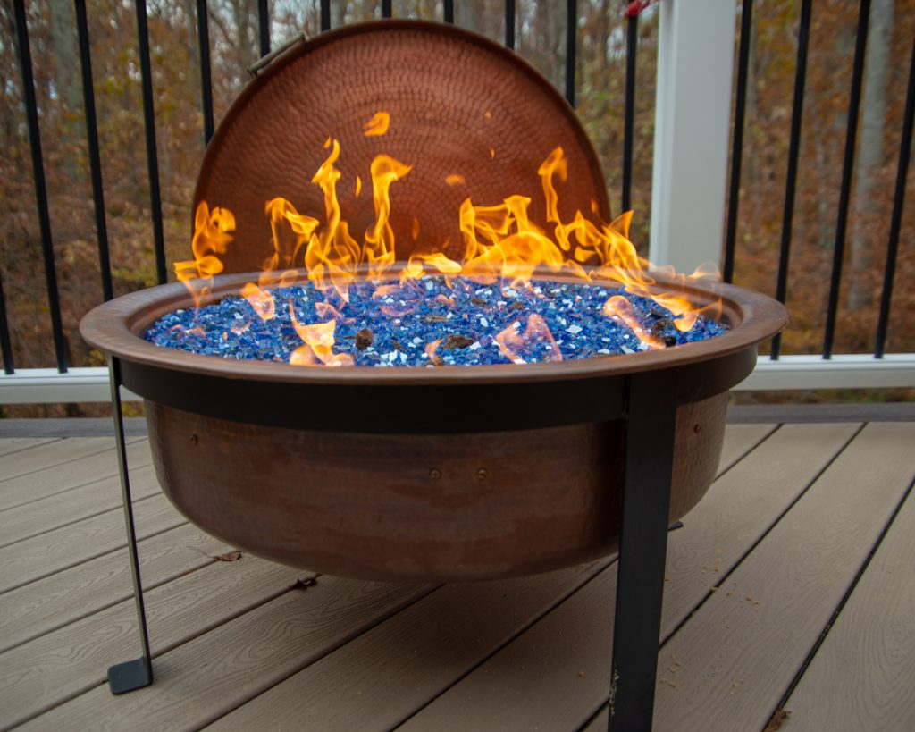 The contrast between the blue glass and the copper fire pit makes for an eye-catching display