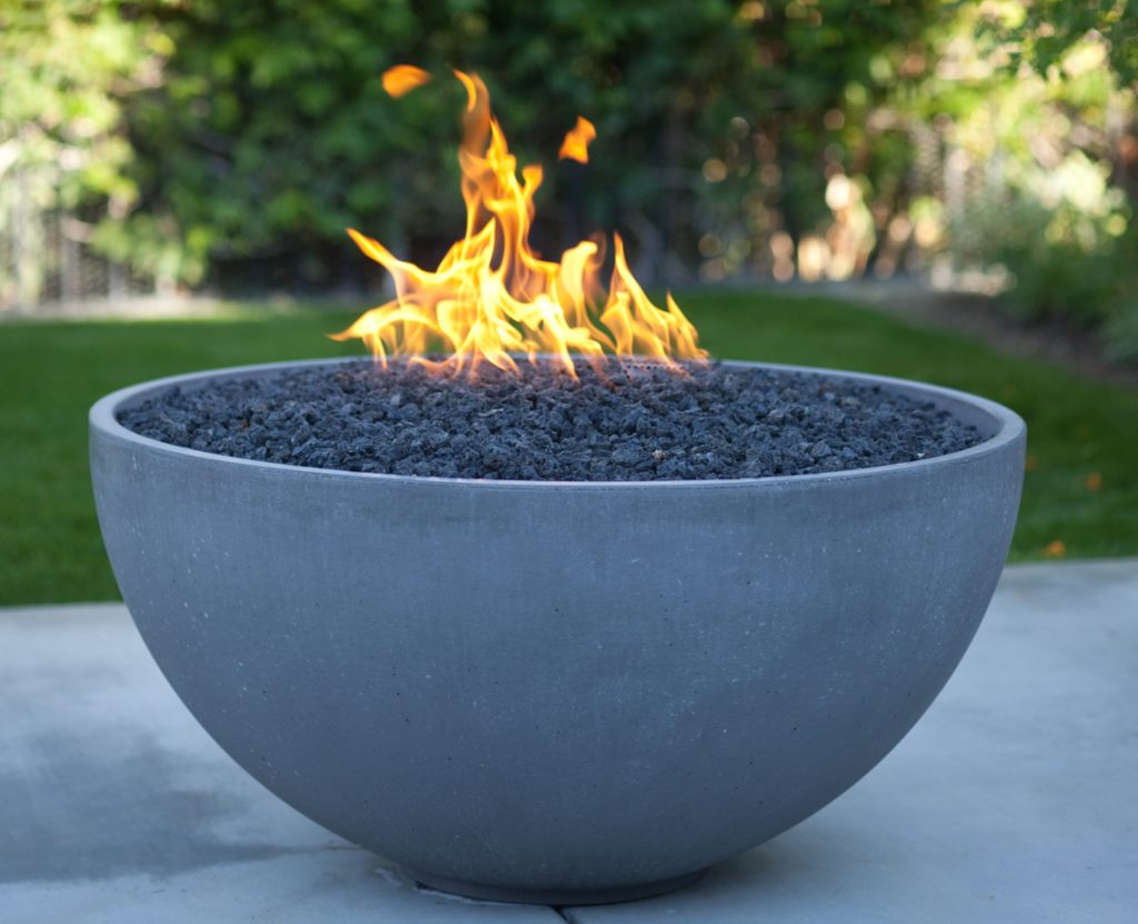 Gas fire pits come in all shapes and sizes, from a traditional stone enclosure to this modern bowl design.